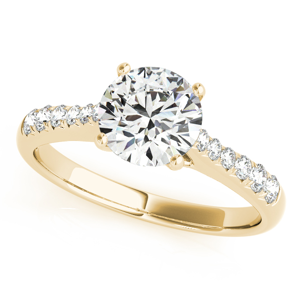 Classically Extraordinary Round Cut Side Stone Engagement Ring
